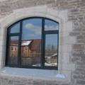 Облицовка фасада дома природным камнем гранит.