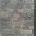 Облицовка фасада выполнена натуральным камнем лемезит.