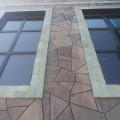 Фасад облицован пиленным камнем лемизит.