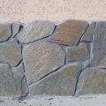 Цоколь облицован окатанным природным камнем серицит