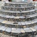 Лестница облицована натуральным камнем серицит.