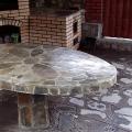 Стол облицован натуральным камнем серицит