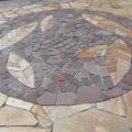 Мозаика выполнена из природного камня златолит и лемезит по эскизу заказчика.
